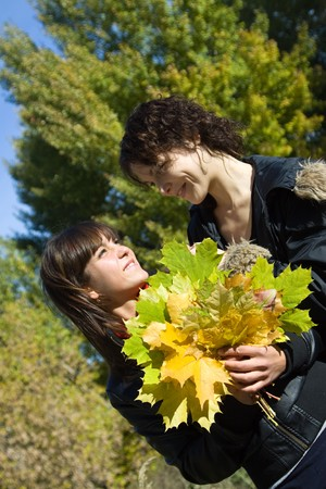 Portrait of two pretty girls in autumn park Stock Photo - 8000898