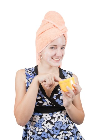 young girl making cosmetic mask. Isolated over white Stock Photo - 8000942