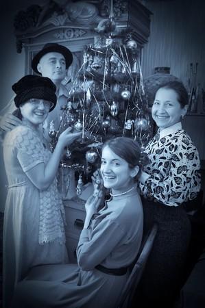 Retro photo of Family near Christmas tree at home Stock Photo - 8071629