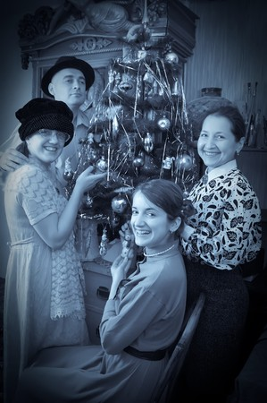 Retro photo of Family near Christmas tree at home Stock Photo - 8071629