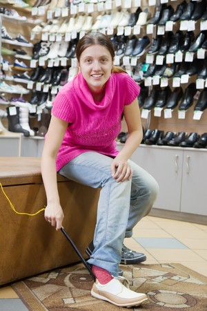 Woman trying shoes for size  at shoes shop Stock Photo - 8071667