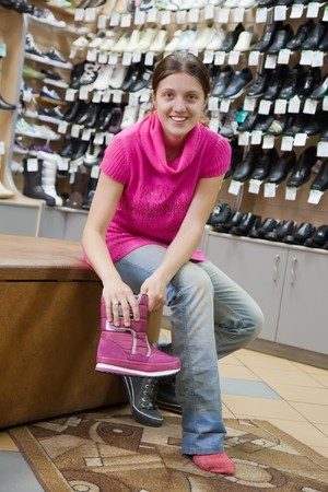 Woman trying shoes for size  at shoes shop photo