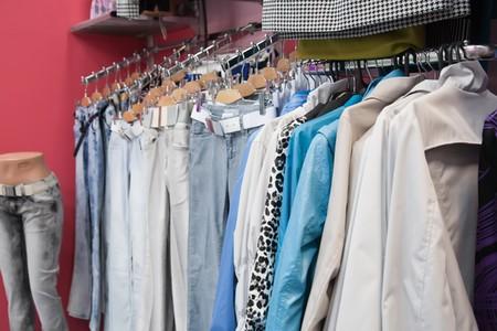 Many dresses on raks at clothes shop