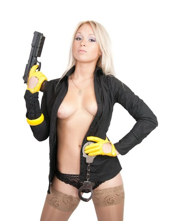 Sexy girl with gun and manacles over white Stock Photo - 8071734