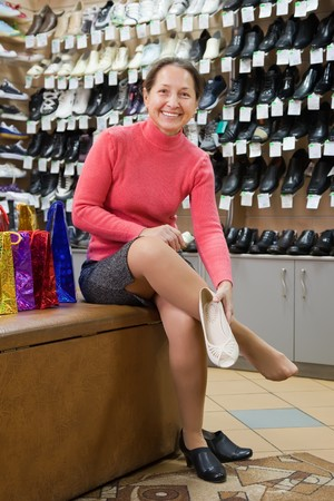 Mature woman trying shoes  for size  at shoes shop Stock Photo - 8071784