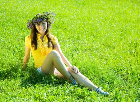 chaplet:  young girl in chaplet sitting on meadow  grass