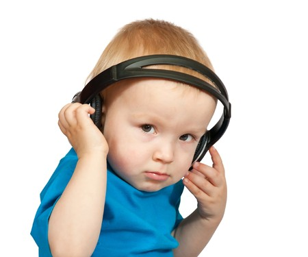 small boy with headphones over white background photo