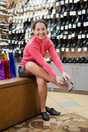 Mature woman trying shoes  for size  at shoes shop Stock Photo - 8071866