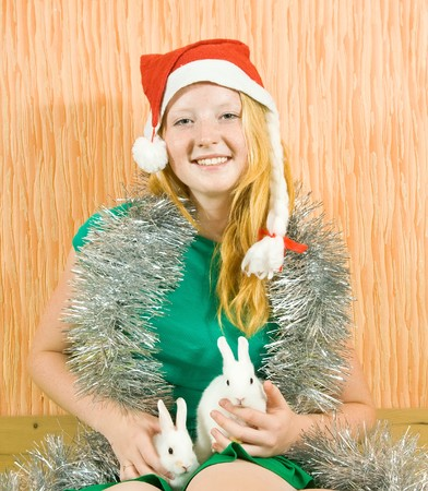 tawdry: teen girl in santa hat  with two pet rabbits