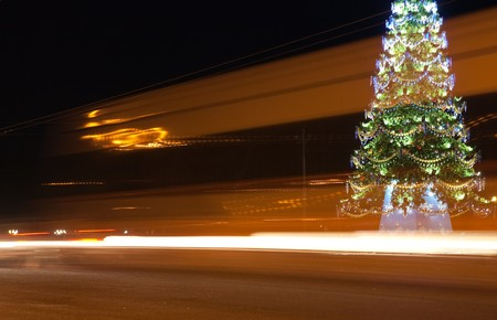 traffic on night road against  illuminated  Christmas tree at night city Stock Photo