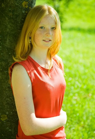 teener: Portrait of red-haired teenager girl against nature