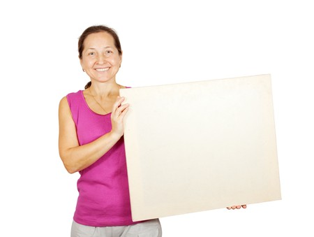 woman holding sign: mature woman holds blank canvas. It is isolated on a white background  Stock Photo