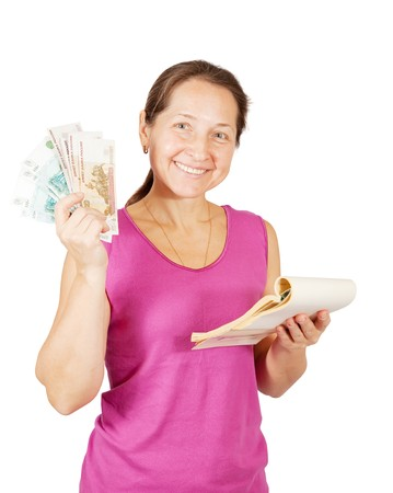 Happy mature woman with notebook and money over white background photo