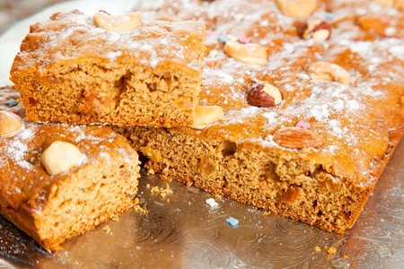 homemade fresh  honey cake with nuts on tray. The end of cooking of  honey cake.  See series photo