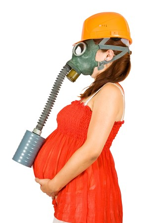 drollery: Portrait of  woman in hardhat and gas-mask holding pregnant belly  over white