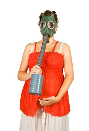 drollery: Portrait of  pregnant woman in  gas-mask holding  belly  over white
