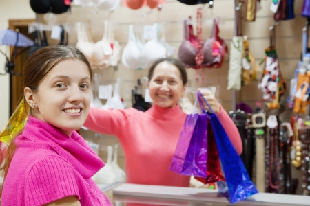 Girl with purchases at  counter in underwear shop photo