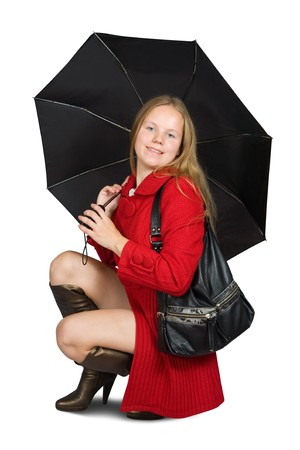 Pretty  girl in cloak with umbrella. Isolated over white