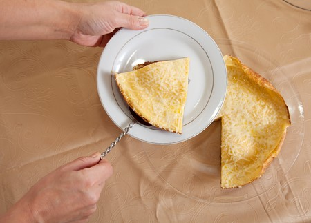 Cook hands with  omelet in plate. The end of cooking omelette.  See series photo