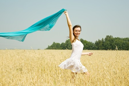 Happy young woman in white dress at field Stock Photo - 8202258