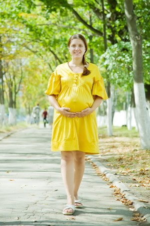Full length of 9 months pregnant woman walking on street Stock Photo - 8202292