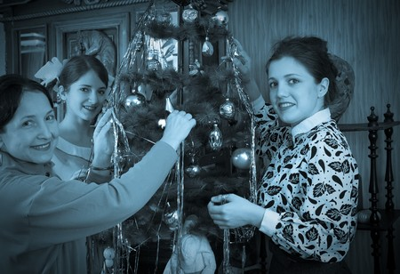 Vintage photo of Family decorating Christmas tree at home Stock Photo - 8202298