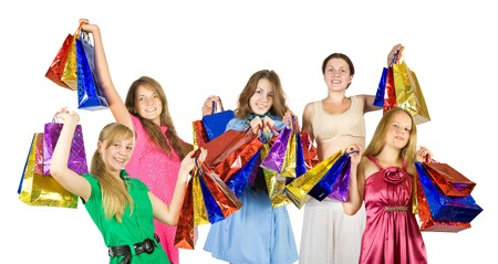 Happy girls with shopping bags. Isolated over white background photo