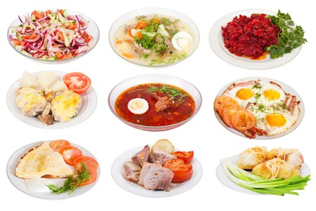 9 various food on plates. Isolated over white background with clipping path photo