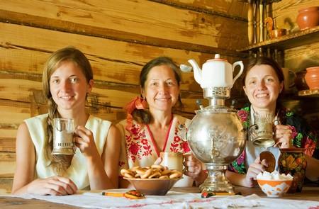 three women having tea in russian traditional interior photo