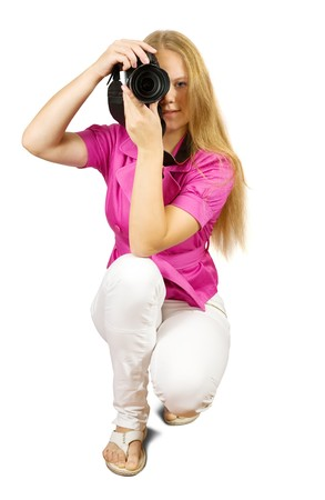 Girl wearing pink holding camera and taking photo photo