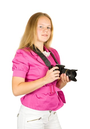 Young girl with camera. Isolated over white background photo