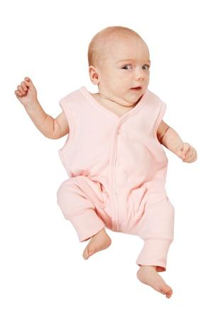 babygro: Little baby girl in pink  over white background Stock Photo