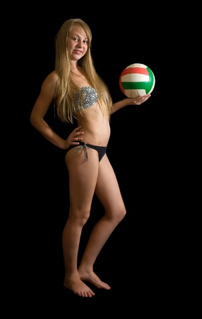 sporty girl posing with ball  against black Stock Photo - 8273601