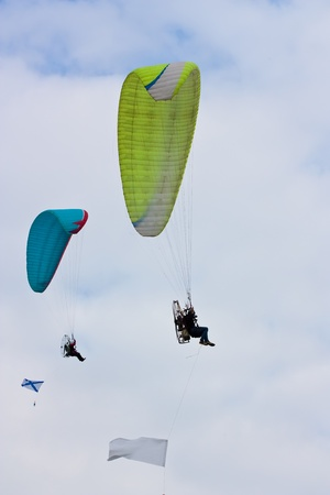 parapendio: Two Paraglider  soaring against cloudy sky  ib summer