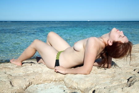 beauty topless girl sunbathing on the coral coast Stock Photo - 8333946