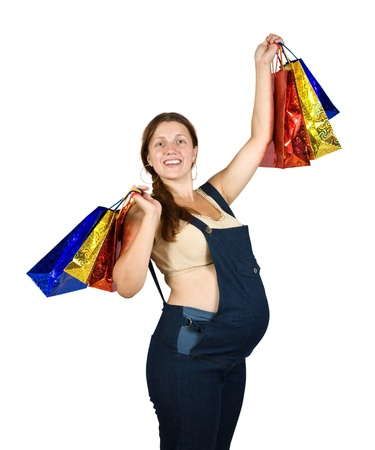 pregnant woman with shopping bags. Isolated over white background photo