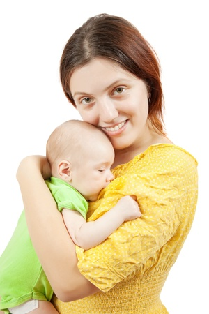 Happy mother with her  newborn baby. Isolated over white photo