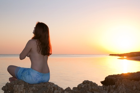 silhouette of girl doing yoga against sunset of a sun Stock Photo - 8333963