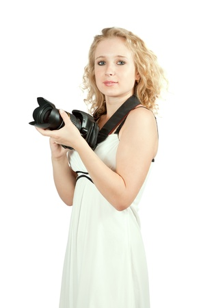 girl with camera. Isolated over white background photo