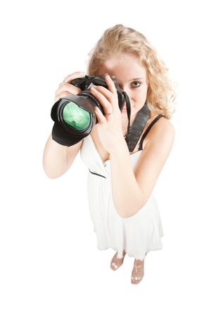 Top view of photographer girl with camera. Isolated over white background photo