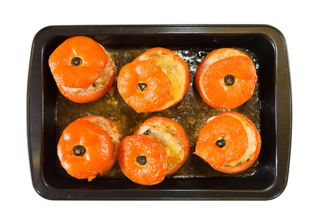 farci: cooked baked stuffed tomato over  white. See in series stages of cooking of farci tomato  Stock Photo