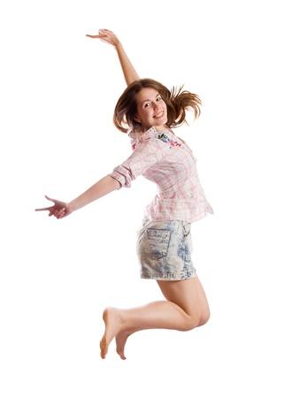 persona saltando: Saltar a chica de pelo larga. Aislados sobre fondo blanco Foto de archivo