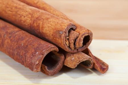 'cinnamon bark': cinnamon bark over wooden surface of table