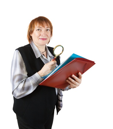 senior woman reading documents through magnifier. Isolated over white photo