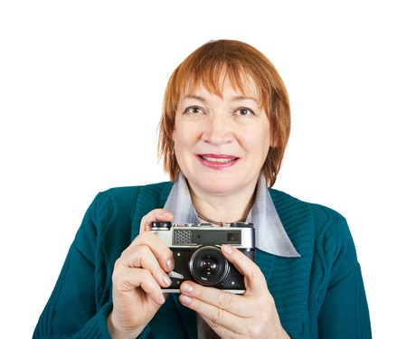 analogue: Senior woman with analogue camera. Isolated over white background