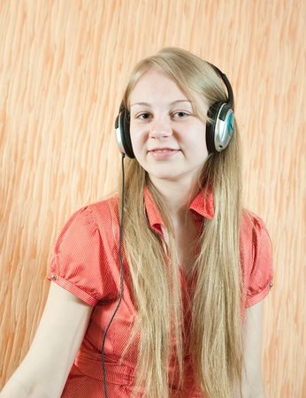 Young beautiful happy girl listening music in headphones Stock Photo - 8382748