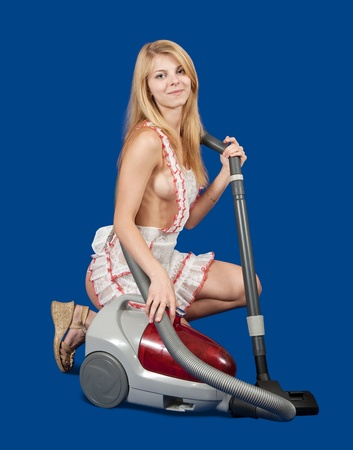 sexy maid: Sexy maid with vacuum cleaner over blue