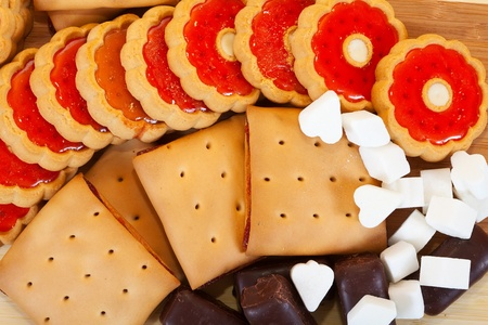 various cookies and  chocolate candy with  sugar   photo