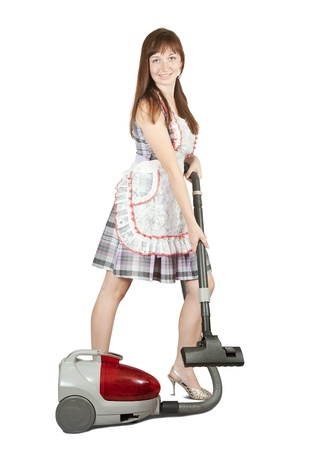 Girl in with vacuum cleaner. Isolated over white background Stock Photo - 8382849