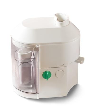 juice squeezer: Home white juice squeezer on white background Stock Photo